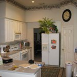 White Refreshes Outdated Cabinets